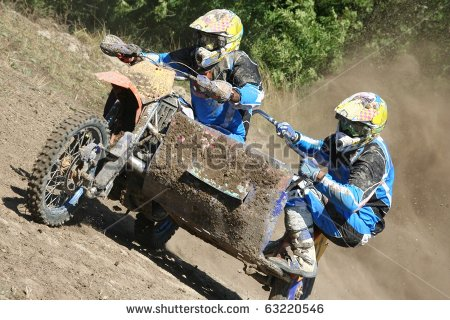 Motocross sidecar (Sidecarcross) team climb a hill